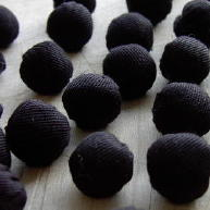 Black gabardine cloth ball buttons