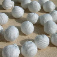 White gabardine cloth ball buttons