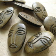 Carved horn face buttons