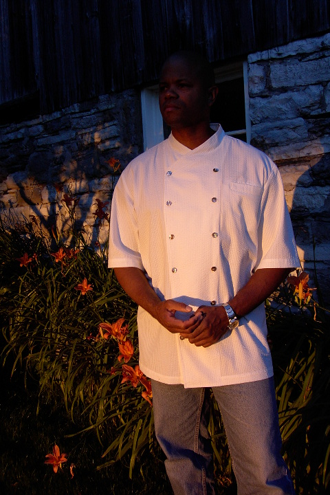 Chef Coat Style BSM101: Shown in White, 100% cotton seersucker, left chest tailored welt pocket, short sleeves & Abalone buttons.