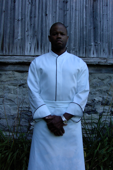 Chef Coat Style CBM103H: Shown in white, 100% cotton Supima® gabardine, with black piping (collar, front & cuffs).