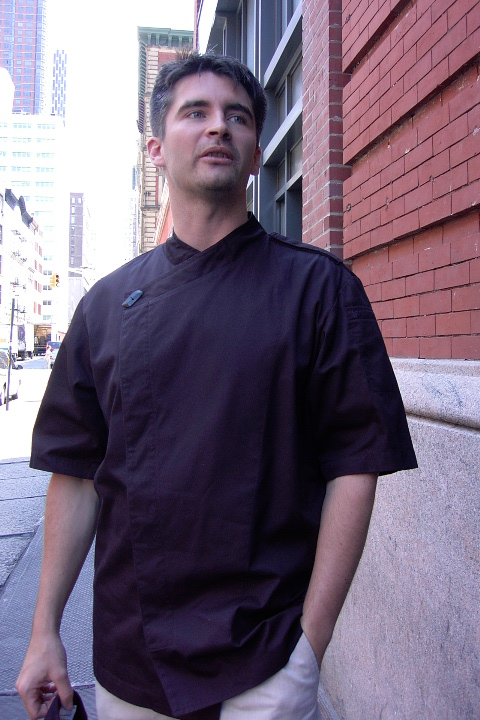 Chef Coat Style BSM105H: Shown in black, 100% cotton gabardine, short sleeves, left shoulder epaulette & one horn button.