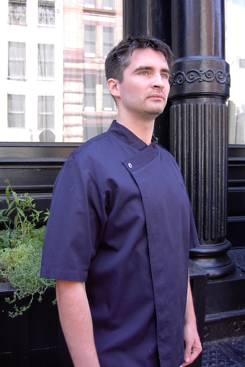 Chef Coat Style BSM105H: Shown in navy, 100% cotton Gabardine, short sleeves, left chest tailored welt pocket & one abalone button.