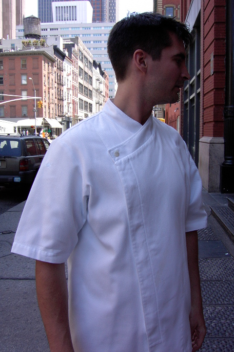 Chef Coat Style BSM105H: Shown in white, 100% cotton Gabardine, short sleeves, left sleeve tailored welt pocket & one faux mother-of-pearl button.