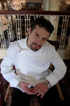 Chef Coat Style BSM105H: Shown in white, 100% cotton gabardine with one brass button.