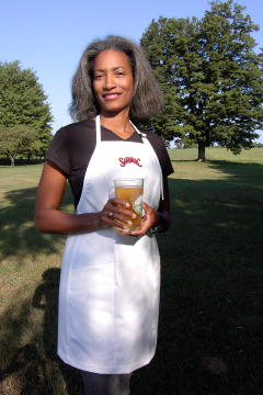 Women's Bib apron style W740; Shown in white, 100% cotton gabardine with two side hip, on seam pockets & embroidered Saranac logo on center chest.