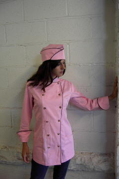 Women's Chef Coat Style BSW100: Shown in Mountain Rose, 100% certified organic cotton, two side hip pockets, brown piping (collar, cuffs & fronts), tiger shell buttons & shown with over seas cap with brown piping.