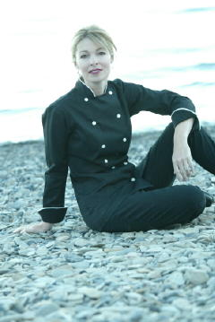 Women's Chef Coat Style CBW100: Shown in Black, 100% cotton Supima� Gabardine, Natural White Piping (collar & cuffs), & Faux Mother-of-Pearl buttons