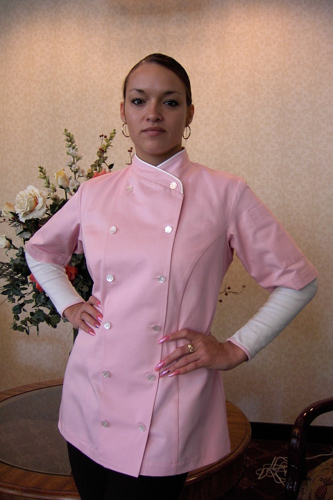 Women's Chef Coat Style BSW101: Shown in Pink, 100% cotton denim, White piping (collar), Left sleeve patch pocket & Faux mother-of-pearl buttons.