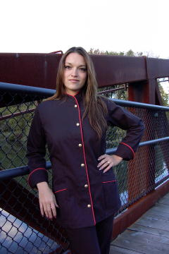 Women's Chef Coat Style BSW103: Shown in black, 100% cotton gabardine, red berry piping (collar, front, cuffs & pockets) two front hip tailored welt pockets, & brass buttons.