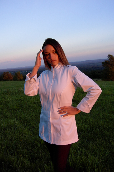Women's Chef Coat Style CBW103H: Shown in white Supima® gabardine, with left shoulder sleeve tailored welt pocket.