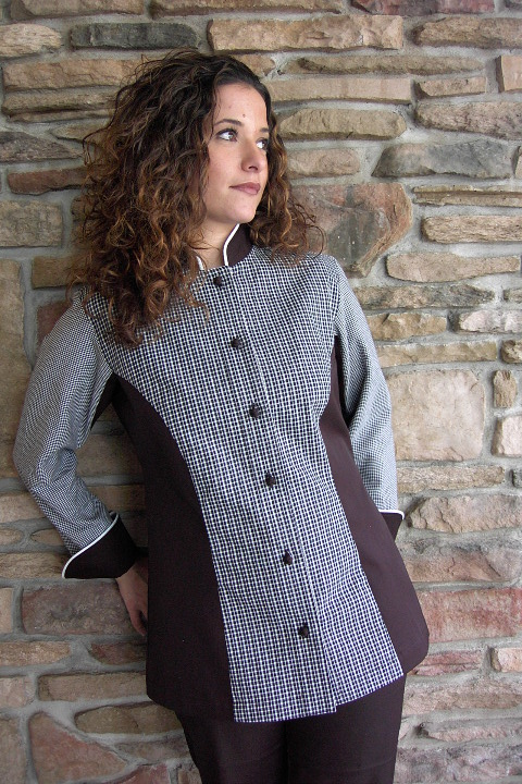 Women's Chef Coat Style CBW104: Shown in white & black plaids & checks & black cuffs, collar & side panels, 100% cotton Supima® Gabardine, snow white piping (collar & cuffs) & hand tied knot buttons.