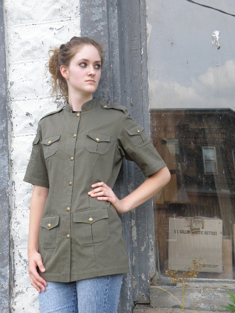 Women's Chef Coat Style BSW104: Shown in Jalapeno green @ Tiger Stripe Camo, 100% cotton denim and 100% combed cotton ripstop, 6 pockets, short sleeves, & brass buttons.