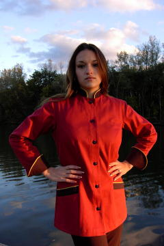 Women's Chef Coat Style BSW104: Shown in red & black, 100% cotton denim, two front hip tailored welt pockets, cheviot gold piping (collar, cuffs & pockets) & pin shank buttons.