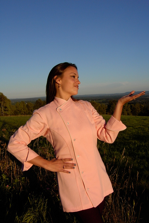 Women's Chef Coat Style BSW105: Shown in Peach, 100% cotton petti point pique, ivory piping (cuffs, collar & front) & faux Mother-of-Pearl buttons.