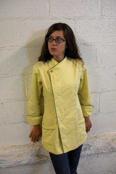 Women's Chef Coat Style BSW105H; Shown in Yellow 100% certified organic cotton gabardine with meadow piping (collar, front, cuffs & pockets) & one peapod green self-covered top button.