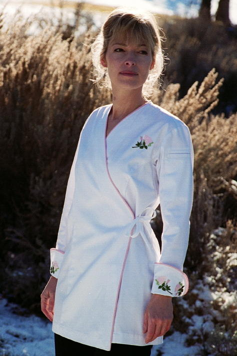 Women's Chef Coat Style BSW106: Shown in White, 100% cotton gabardine, Pink Sham piping (cuffs, collar & front), left sleeve tailored welt pocket & Rose embroidery (3 on each cuff & one on the left chest).