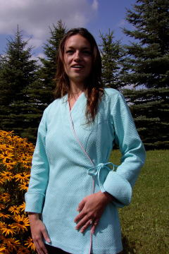 Women's Chef Coat Style BSW106: Shown in Aqua, 100% cotton Honeycomb pique with pink sham piping (cuffs, collar & front).