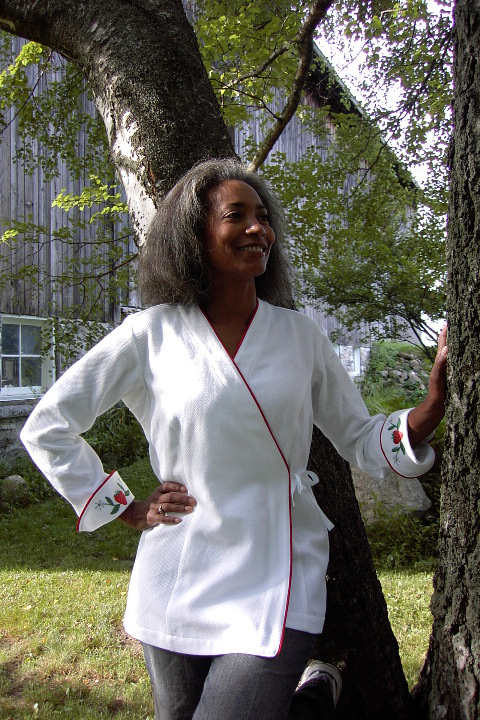 Women's Chef Coat Style BSW106: Shown in White, 100% cotton petti point pique, red berry piping (cuffs, collar & front), & strawberries & flowers embroidery (one on each cuff).