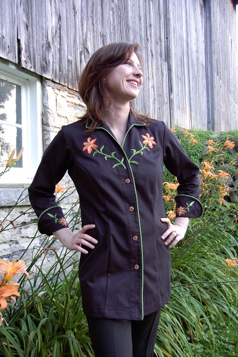 Women's Chef Coat Style BSW109: Shown in Black, 100% cotton gabardine, Meadow piping (collar, cuffs and front), Awabi buttons & Tiger Lilly embroidery (chest, cuffs & back).