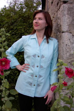 Image of Women's Chef Coat (Chef Jacket) Style BSW109: Shown in Aqua, 100% cotton, decorative knot embroidery (eight on the front & one on center back) & concho buttons.